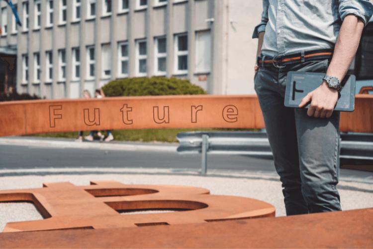 Man standing on bitcoin floor near building holding tablet