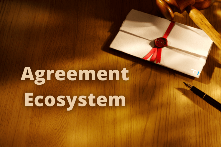 agreement ecosystem written on wooden block with pen and paper on side