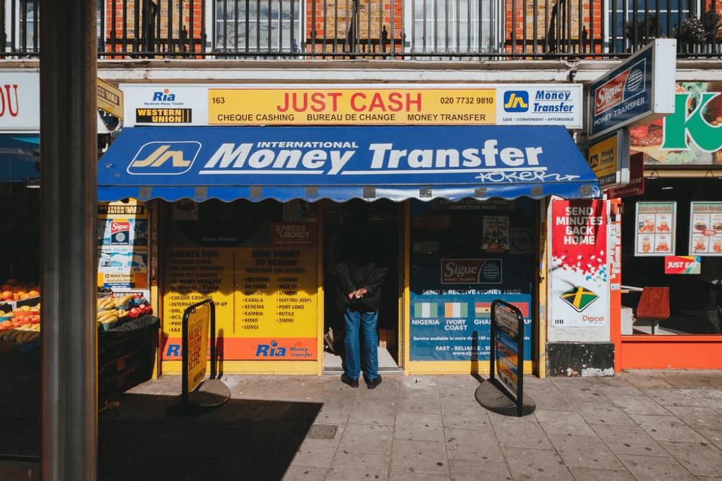 man standing at Money transfer shop