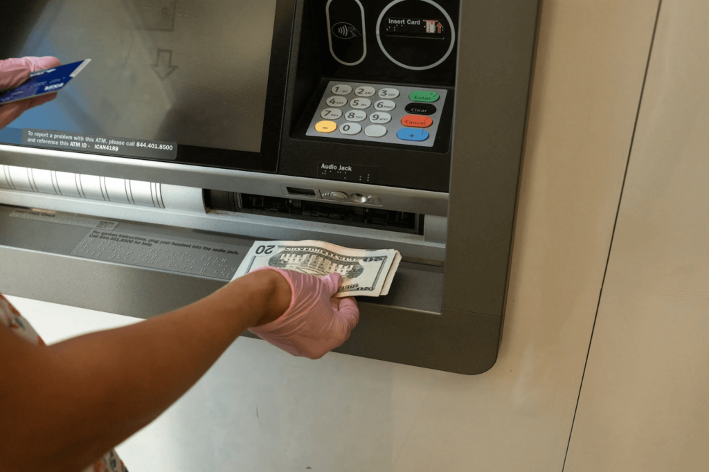 withdrawal of dollars from ATM machine