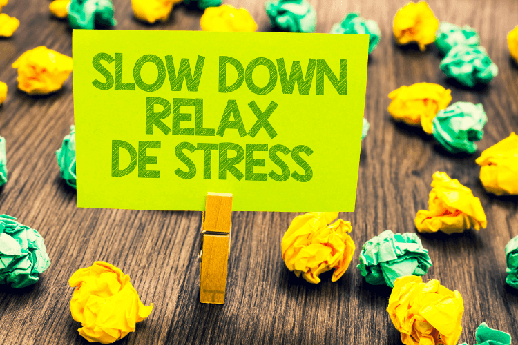 a clip holding green sticky not with -- heading slow down relax de stress