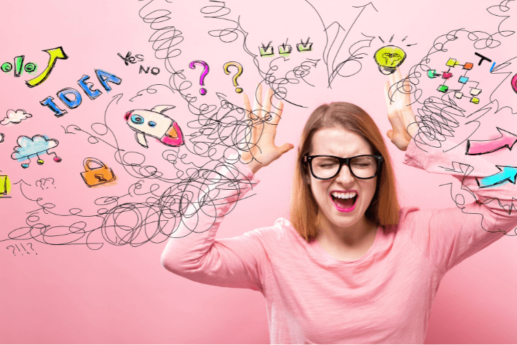 woman shown in pink, is getting stressed with ideas, information overload & decisions to make.