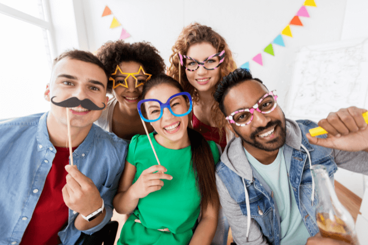 5 people with various face props enjoying in office