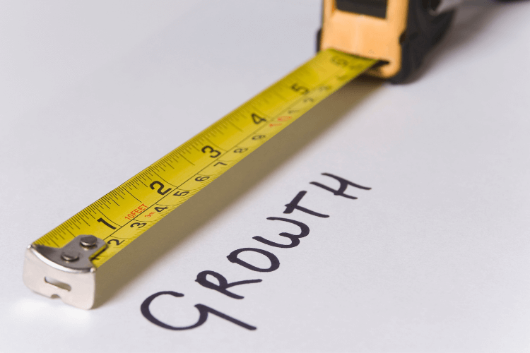 growth with measuring tape